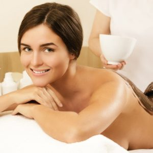 happy-young-woman-during-chocolate-wrap-massage_144962-8504